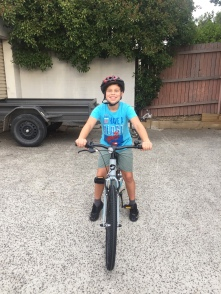 Spider Boy got his first proper bike with no training wheels! And was riding it within an hour of getting it, thanks to his Dad.